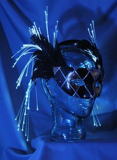 One of a kind, hand painted, glowing masquerade mask. Made with feathers and fiber optic lights.  www.teamrainbowdesigns.com #halloween #mask #glowing #masquerade #unique #onsale  #mardigras #fantasy #accessory