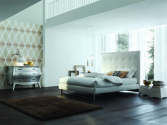 Tall white leather headboard perfect for a modern home