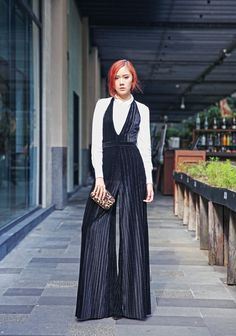 Gorgeous pleated jumpsuit over a white blouse