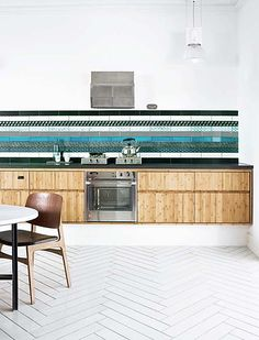 wooden kitchen with stripes of different tiles