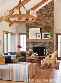 Stone #fireplace in a Modern, Rustic Mountain Home designed by Trip Haenisch.
