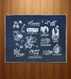 Printed on denim, this screenprint illustration features a feast of winter fruits, veggies and sides.