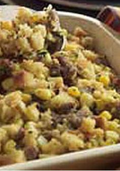 Corn and Sausage Stuffing — Cornbread stuffing mix is mixed with pork sausage and corn for a tasty side dish recipe that's great for everyday holiday entertaining.