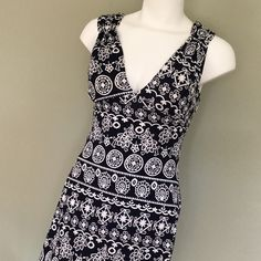 Touch Express Sun Dress Navy & White Touch Express Sun Dress, so pretty. Heavy stretch fabric with lightly padded bra area. Navy background with white designs. Super sharp, super stretchy. Brand new with tags. Size Large but fits like a designer large. Touch Express Dresses