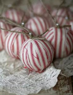 Red ticking fabric ornaments with jute twine hangers.