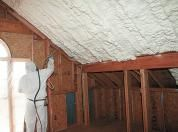 It costs two to three times more than fiberglass batt insulation. But the roof is a major pathway to heat loss—and gain—so it's worth shelling out the extra bucks for spray foam. It forms a much tighter air barrier, and you'll get the same R-value with fewer inches of the stuff, so you'll have extra room overhead.