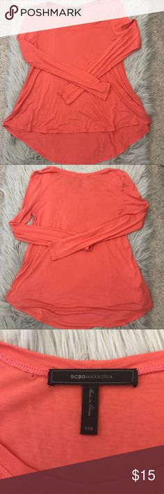 BCBG long sleeve coral top size XXS Great condition, it does have a little hole next to the tag from ripping off the store tag. BCBG Tops Blouses