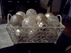 fun xmas balls in an antique cream basket decor