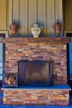 Rustic Wood Mantel with stone surround.