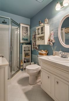 Traditional 3/4 Bathroom with limestone tile floors, Wall sconce, Lamps Plus Laura White Finish Oval Wall Mirror