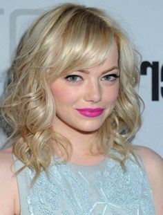 Emma Stones Blonde Locks Medium Cut with Swept Bangs - Great look for women with fine curly hair.