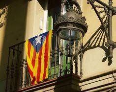 This Estelada Flag Photograph was taken in Barcelona Neighbourhood summer 2013. The Estelada - by Lost Kat Photo lostkat.com