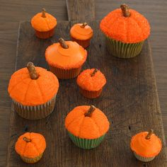 Make these pumpkin-themed cupcakes for your next Halloween party: http://www.bhg.com/halloween/recipes/17-frightfully-good-halloween-cupcakes/?socsrc=bhgpin101014easypumpkincupcakes&page=4