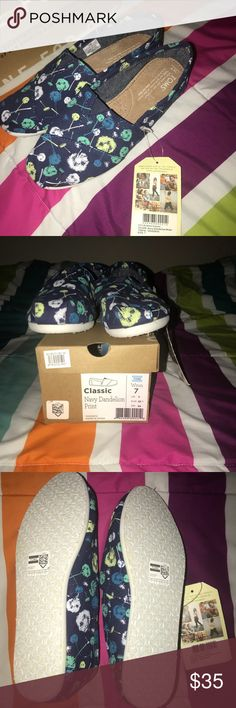 NWT Toms slip on navy dandelion print size 7 Brand new with tags and box Toms women's slip on classic shoes size 7 navy dandelion print Toms Shoes