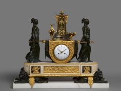 A highly important Louis XVI mantel clock by Lépine, 1785-1790, France. Gilt and patinated bronze and white marble mantel clock of eight day duration representing the Vestal Virgins Carrying the Sacred Fire, with movement by Pierre-Claude Raguet-Lépine, housed in a magnificent case attributed to Pierre-Philippe Thomire.