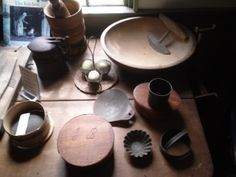 Photo taken 2014: Table top with collection of  antique cooking and kitchen implements. As seen in the Old Kitchen of the Historic Atwood House, Chatham, MA. #atwoodhouse, #kitchen, #cooking, #1800s, #chathamhistoricalsociety, #chatham, #capecod