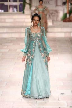 Beautiful Organza weave silk Skirt and embroidered jacket style dress with modern silhouettes. Indian Gowns, Indian Attire, Pakistani Dresses, Indian Outfits, Indian Designer Outfits, Designer Dresses, Heavy Dresses, Kurti Designs Party Wear, Anarkali