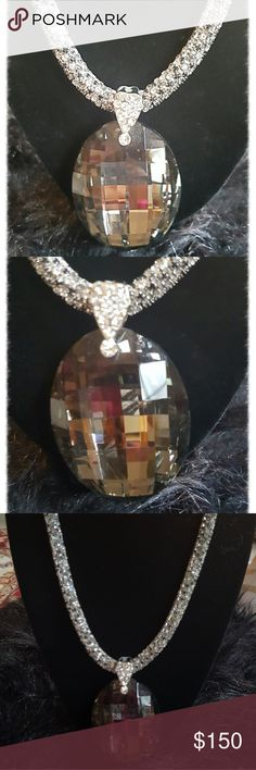 "STUNNING SMOKY TOPAZ COSTUME PIECE Talk about the WOW factor!!!  This pendant is absolutely gorgeous. A full 3"" smoky topaz hangs from a thick rope chain done in silver + rhinestones to create a dazzling effect. Would GLAM up any outfit in your closet!  NWOT. Neiman Marcus Jewelry Necklaces"