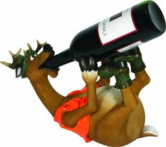 The Rivers Edge Deer bottle holder is the perfect humorous accent to any outdoors man's décor.  This unique piece, which is beautifully hand painted and features amazing detail, is without a doubt one of our top selling items.  Each silly deer can wet his whistle with any standard 750 mL wine bottle.  This piece also works great for displaying whiskey, beer and other beverages.