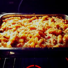 Rotini pasta, your favorite pasta sauce, hot Italian sausage (or your choice of meat), and mozzarella cheese. Brown sausage in a pan Add sauce Pour over cooked pasta Top with cheese  Bake at 350 for 20 mins