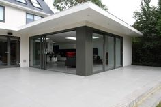 Ugly house externally remodelled and extended to create a traditional front facade and sleek modern rear with open plan living. Bungalow Extensions, Garden Room Extensions, House Extensions, House Extension Design, Roof Extension, Extension Ideas, Roof Design, Exterior Design, Dream Home Design