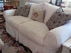 slipcover made from a painter's drop cloth--I wish I had sewing skills like that!!
