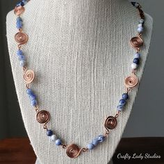 Well color me blue with envy! This necklace boasts 6mm sodalite stones, copper swirl connectors, and a copper shepherd's hook clasp. You will make a bold statement with this around your neck!