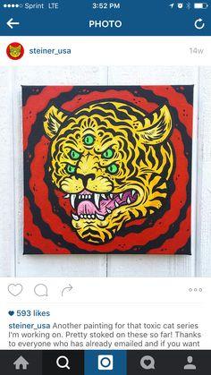 Multiple eyed tiger head