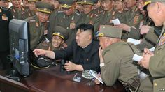 An undated handout picture released by the North Korean Central News Agency (KCNA) on 27 April 2014 shows North Korean leader Kim Jong-un (C) looking at a computer screen along with soldiers of a long-range artillery unit at an undisclosed location in North Korea.
