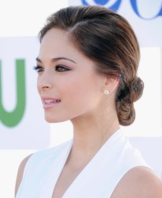 Lavender shadow and black liner plays up  hazel eyes. (Let's ban pale/frosty pink lips from warm skin-toned women forever, though.) Kristen Kreuk.