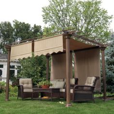 Garden pergola ideas. Nice with the fabric roof.
