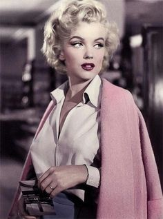 Marilyn Monroe wearing a white blouse and pink cardigan and red lipstick. Pretty Retro Vintage Fashion Style Icons; www.prettyretro.co.uk