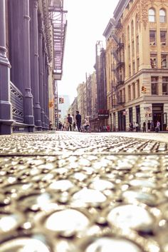 New York City: Soho: Enjoy the interesting perspective while at ground level looking out over an intricately designed glass sidewalk towards the classic architecture of this Manhattan neighborhood.