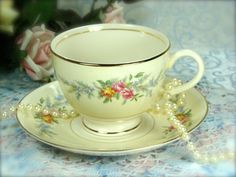 Lovely Cream Colored Vintage Teacup and Saucer by HappyGalsVintage