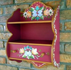 Beautifully decorated set of shelves painted with Bauernmalerai designs