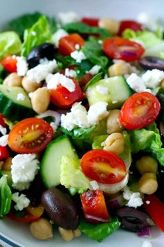 A quick, easy and healthy salad with tomatoes, cucumbers, red onions, garbanzo…