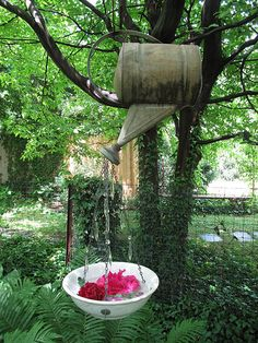 *This watering can hangs from the tree, crystals are hanging from the spout, looks like water...great idea!