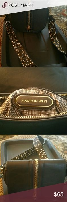 Madison West- NWOT Beautiful black purse, gold zip pocket in front, and back and beautiful gold detail on the strap. Madison West Bags Shoulder Bags