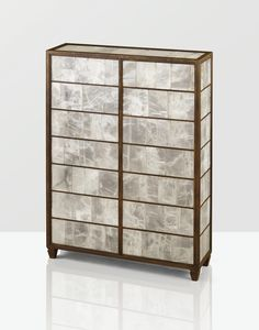 This is a unique cabinet which Jean-Michel designed. This piece of furniture is a great example of something which he has created out of a unique or luxurious material. To the eye you can only wonder what those panels were made from. At first I thought it looked like some form of crushed glass or even seashell. After research I found that it was made from a unique gypsum material, which is a mineral composed of sulfate. I love this cabinet and I feel it would look great in any room.