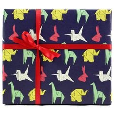 Sweet origami elephants, cranes, and giraffes make for a lovable bunch and irresistible gift wrapping. These fun gift wrapping sheets are great for surprising the little party animals in your life or