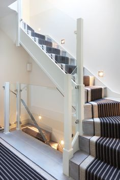 Stylish London mews house re-imagined for loft living, love the runner on the stairs Loft Staircase, Attic Stairs, Modern Staircase, House Stairs, Carpet Stairs, Staircase Design, Staircase Ideas, Handrail Ideas, Staircase Contemporary