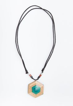 Green Hexagon Mejiku Necklace by Kabau. The series of mejiku necklace that mostly has variety of colors at the necklace. Handcrafted with care and made by passion from mapplewood as material in green color from reused skateboard. Unique design with touch of white, brown and black beads also with adjustable stripes black strings.  http://www.zocko.com/z/JKACW