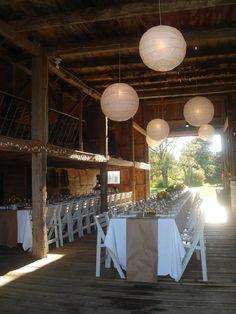 Wedding reception in a barn, simple decor, white paper lanterns. #wedding #barn #lanterns