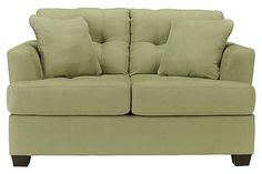 """The Zia - Kiwi Loveseat from Ashley Furniture HomeStore (AFHS.com). Capturing the true excitement and style of Metro Modern design, the """"Zia-Kiwi"""" upholstery collection awakens any living area with a sleek contemporary beauty along side the plush comfort you've been searching for."""