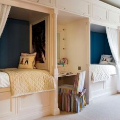 Sophisticated way to give your kids more privacy in a shared bedroom. I love the drama of the dark blue walls and all the built in storage space is fantastic! - or let the kids pick their own color for their space.
