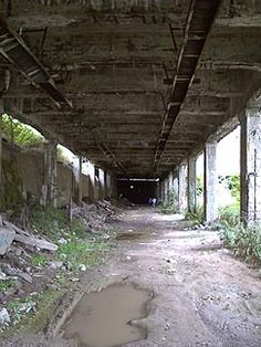 Rochester, NY Subway.  It was opened in 1927, but it never built tracks to take people to and from the suburbs, and by 1957 it was out of business.  Much of the track was simply abandoned.