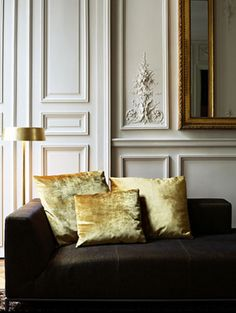 Three panel door, velvet pillows, and paneling painted the perfect cream