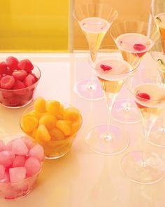 """Cocktails Cocktails Cocktails ... Dazzling Drinks ...                                                        Mixology meets gemology with these flutes of Prosecco garnished with pink, yellow, and fuchsia """"diamond"""" ice cubes."""