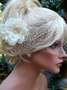 This might be the one!!!!!!!    Ivory or White Flower Bridal Fascinator pearls by kathyjohnson3, $59.00