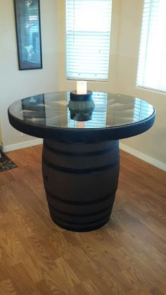 Our Wagon Wheel/ Wine Barrel table Wagon Wheel Table, Wagon Wheel Decor, Rustic Furniture, Diy Furniture, Wine Barrel Table, Western Living Rooms, Wine Decor, Rustic Table, Glass Table